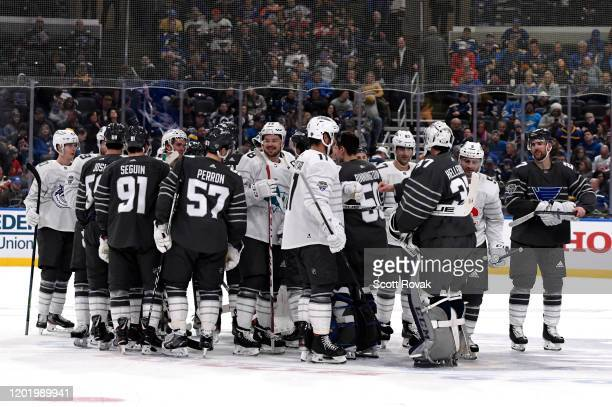 The Pacific Division and Central Division players shake hands after the 2020 NHL AllStar Game between the Pacific Division and Central Division at...
