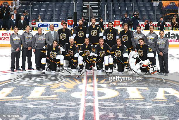 The Pacific Division team and head coach Darryl Sutter 4th standing from left pose for a team photo prior to their 2016 Honda NHL AllStar Western...