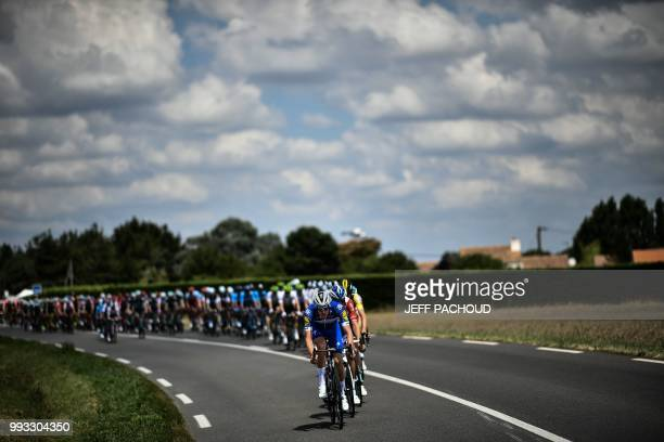 The pack chases a thre-men breakaway during the first stage of the 105th edition of the Tour de France cycling race between Noirmoutier-en-l'ile and...