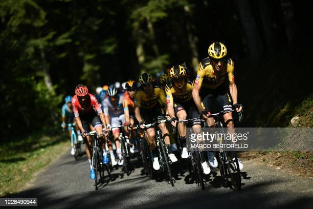The pack climbs the Col de la Biche during the 15th stage of the 107th edition of the Tour de France cycling race, 175 km between Lyon and Grand...