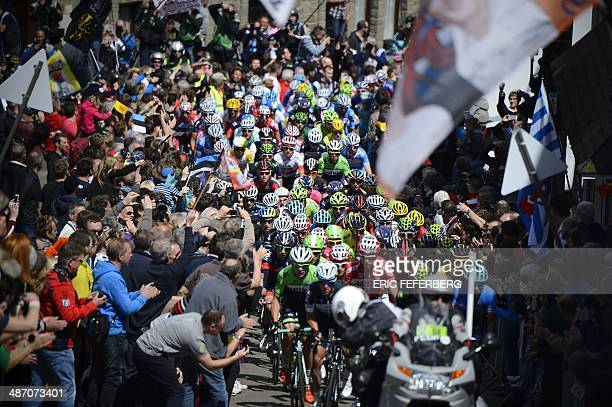 The pack climbs the St Roch hill during the 100th edition of the LiegeBastogneLiege oneday classic cycling race on April 27 2014 AFP PHOTO / ERIC...
