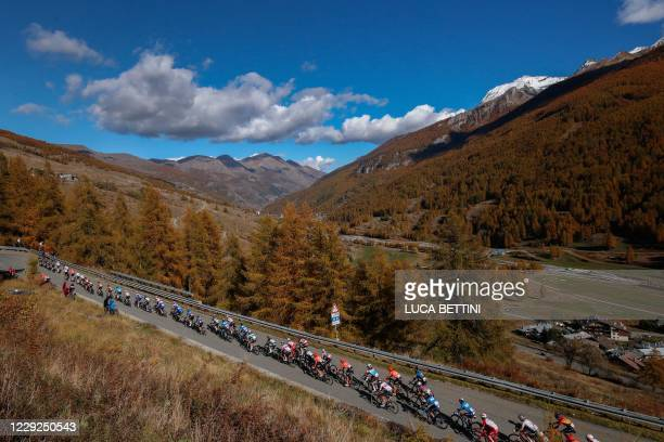 The pack climbs up the mountains with autumn coloured trees during the 20th stage of the Giro d'Italia 2020 cycling race, a 198-kilometer route...