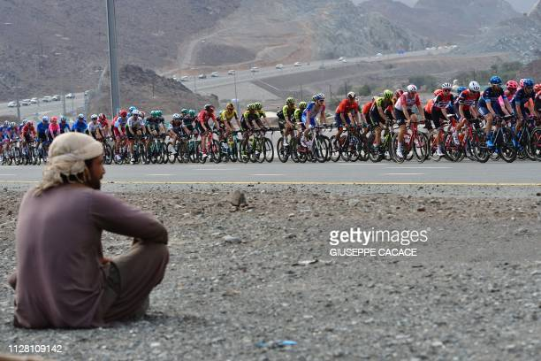 The pack competes during the fifth stage of the UAE tour from Sharjah to Khor Fakkan on February 28 2019