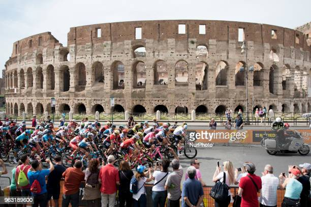 The pack of cyclists pedals past the ancient Colosseum during the last stage of the Giro d'Italia cycling race in Rome Sunday May 27 2018 Britain's...