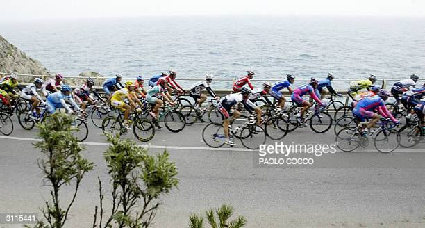 The pack of riders compete at the 95th edition of MilanSan Remo cycling race ride next to the sea in Finale Ligure 20 March 2004 Spain's Oscar Gomez...