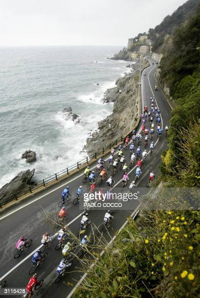 The pack of riders competes at the 95th edition of MilanSan Remo cycling race ride next to the sea in Varazze 20 March 2004 Spain's Oscar Gomez...