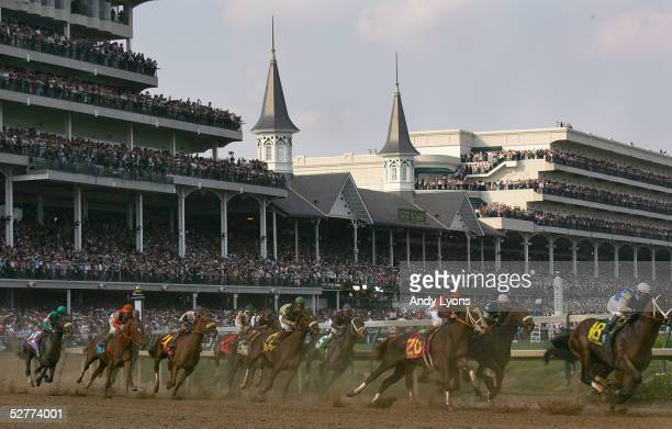 The pack of riders race around turn 1 during the 131st Kentucky Derby on May 7, 2005 at Churchill Downs in Louisville, Kentucky. Giacomo and jockey...