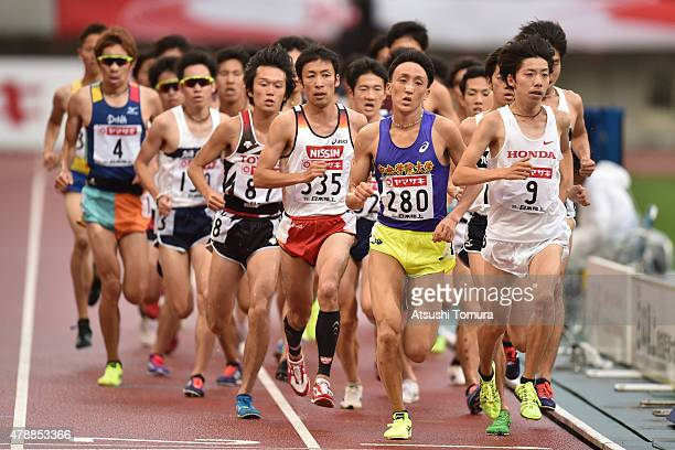 The pack of runners compete in the mens 5000 meter final during the 99th Japan Athletics National Championships at Denka Big Swan Stadium on June 28,...