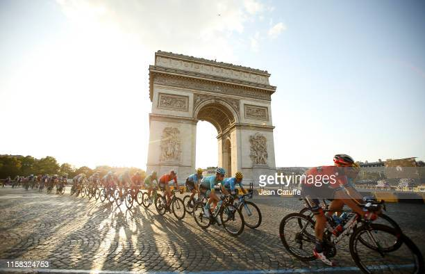 The pack passes in front of Arch of Triumph at the top of Avenue des Champs Elysees during stage 21 of the 106th Tour de France 2019, the last stage...