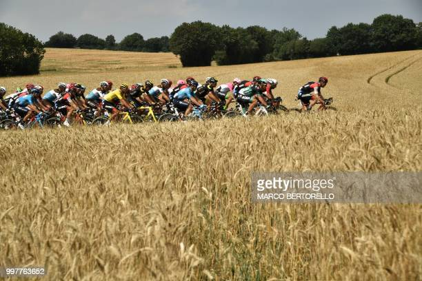 TOPSHOT The pack rides across wheat fields during the seventh stage of the 105th edition of the Tour de France cycling race between Fougeres and...