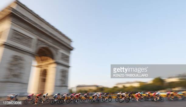 The pack rides around the Arc de Triomphe during the 21st and last stage of the 107th edition of the Tour de France cycling race, 122 km between...