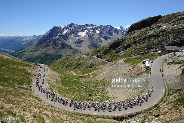 The pack rides at the Col du Galibier on July 23 during the 2105 km seventeenth stage of the 2008 Tour de France cycling race run between Embrun and...