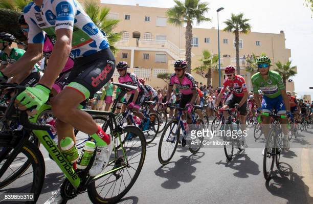 The pack rides at the start of the 9th stage of the 72nd edition of 'La Vuelta' Tour of Spain cycling race a 174km route between Orihuela to Poble...