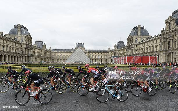 The pack rides by the Louvre Pyramid prior to the arrival of the twentyfirst and last stage of the 102nd edition of the Tour de France cycling race...