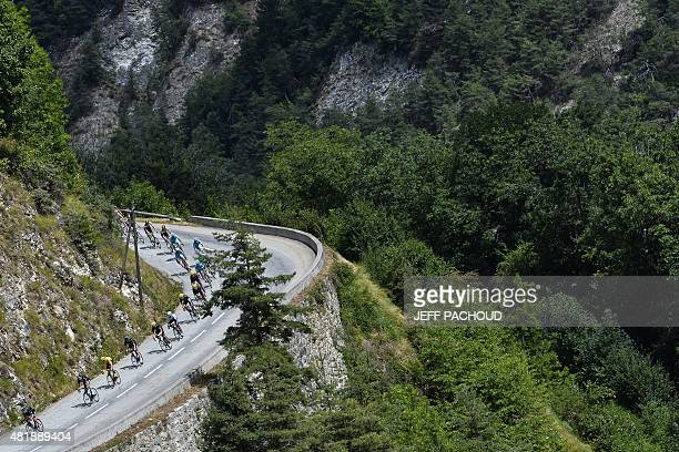 The pack rides during the 1105 km twentieth stage of the 102nd edition of the Tour de France cycling race on July 25 between Modane Valfrejus and...