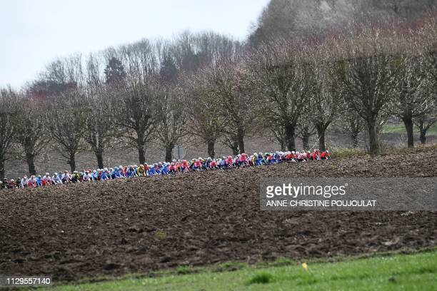 The pack rides during the 1385km 1st stage of the 77th ParisNice cycling race between SaintGermainenLaye and SaintGermainenLaye in SaintGermainenLaye...