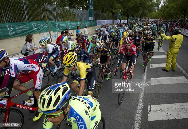 The pack rides during the 14th Stage of the 2015 Vuelta Espana cycling tour a 215km route between VitoriaGasteiz and Alto Campoo Fuente del Chivo on...