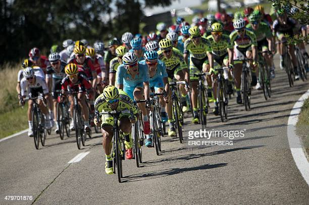 The pack rides during the 159.5 km third stage of the 102nd edition of the Tour de France cycling race on July 6 between the belgian cities of...