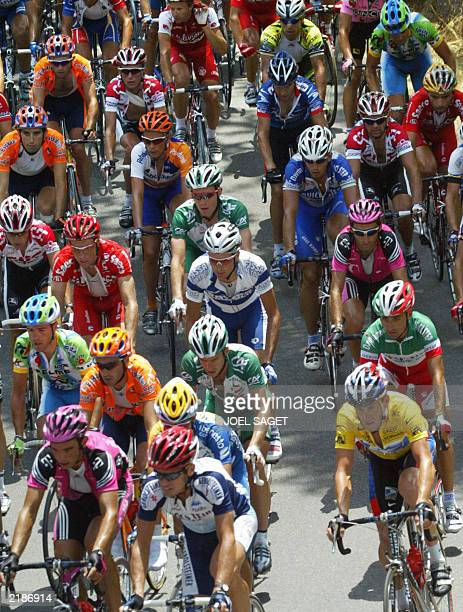 The pack rides during the 15th stage of the 90th Tour de France cycling race between Bagneres-de-Bigorre and Luz-Ardiden, 21 July 2003. AFP PHOTO...