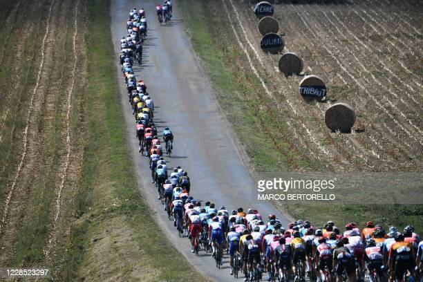 The pack rides during the 16th stage of the 107th edition of the Tour de France cycling race, 164 km between La Tour du Pin and Villard-de-Lans, on...