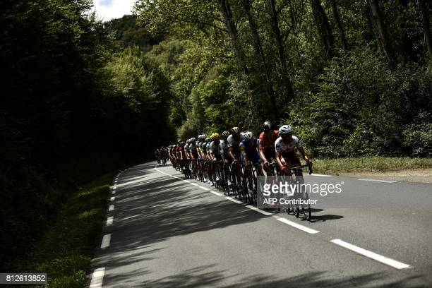 The pack rides during the 178 km tenth stage of the 104th edition of the Tour de France cycling race on July 11, 2017 between Perigueux and Bergerac....