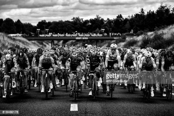 The pack rides during the 178 km tenth stage of the 104th edition of the Tour de France cycling race on July 11 2017 between Perigueux and Bergerac /...