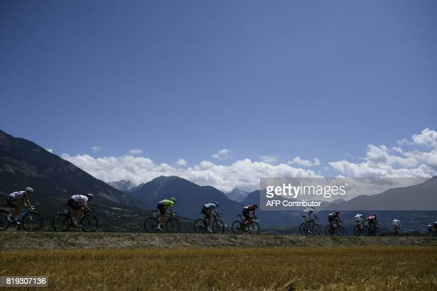 The pack rides during the 1795 km eighteenth stage of the 104th edition of the Tour de France cycling race on July 20 2017 between Briancon and...