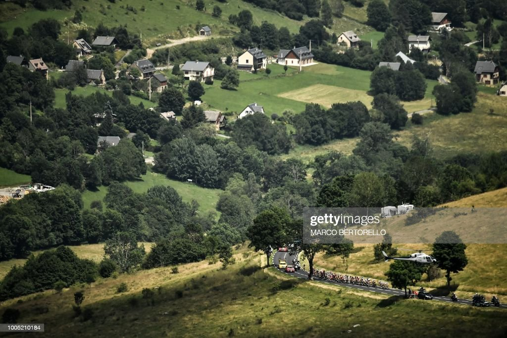 The pack rides during the 17th stage of the 105th edition of the Tour de France cycling race, between Bagneres-de-Luchon and Saint-Lary-Soulan Col du Portet, southwestern France, on July 25, 2018.