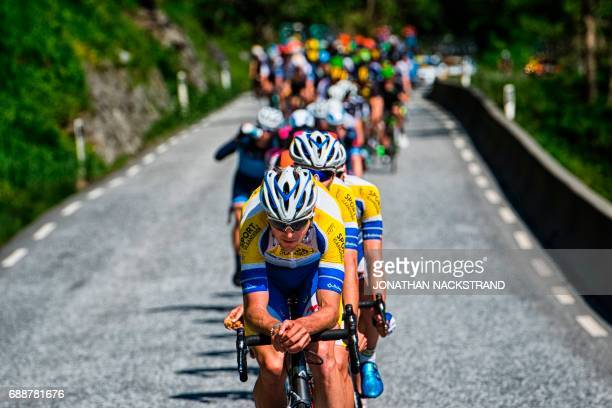 TOPSHOT The pack rides during the 1802 km third stage of the Tour des Fjords between Odda and Karmoy in Norway on May 26 2017 / AFP PHOTO / Jonathan...