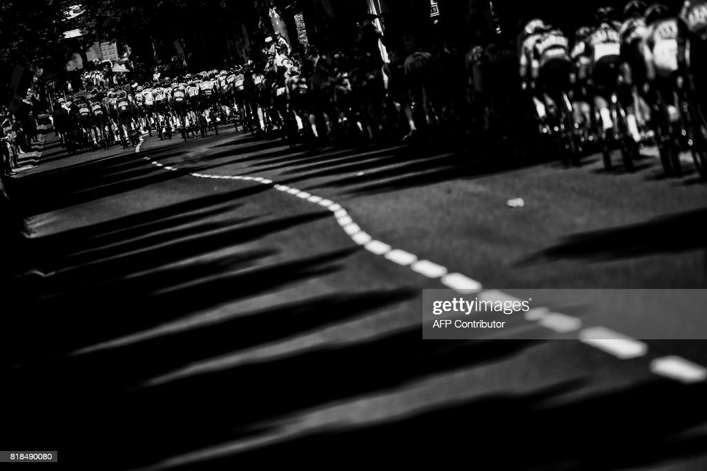 The pack rides during the 181,5 km fourteenth stage of the 104th edition of the Tour de France cycling race on July 15, 2017 between Blagnac and Rodez. /