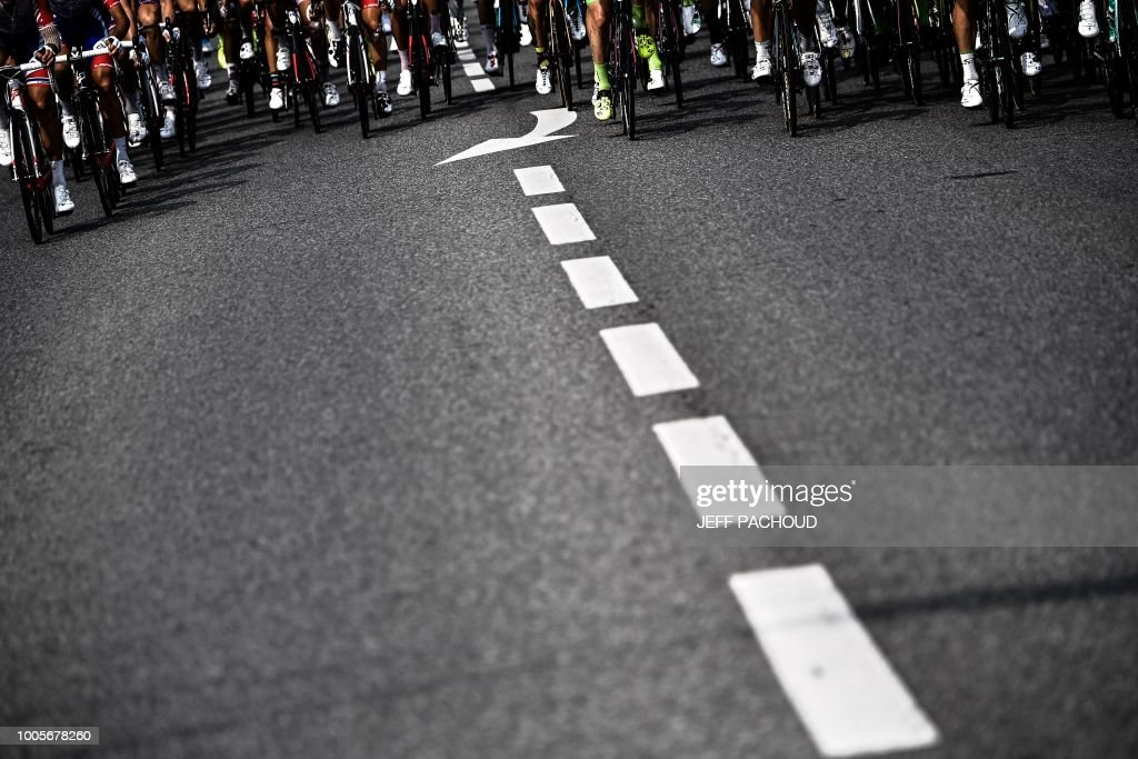 The pack rides during the 18th stage of the 105th edition of the Tour de France cycling race, on July 26, 2018 between Trie-sur-Baise and Pau, southwestern France.