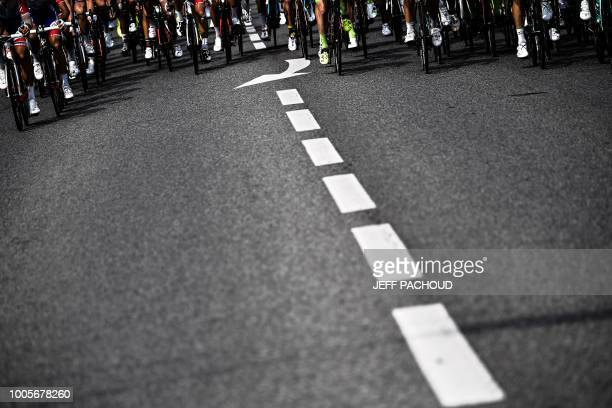 The pack rides during the 18th stage of the 105th edition of the Tour de France cycling race on July 26 2018 between TriesurBaise and Pau...