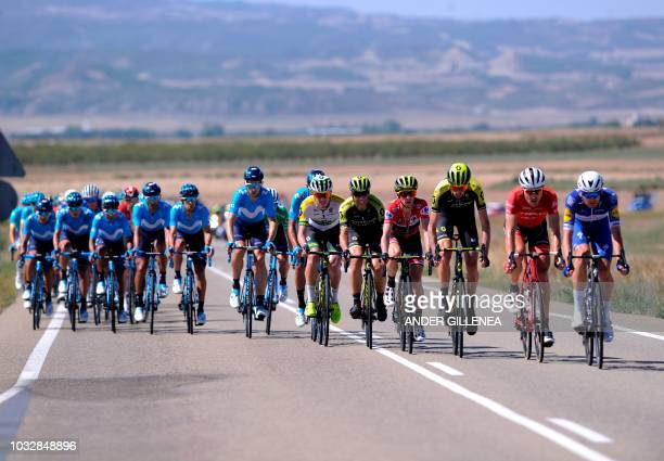 "The pack rides during the 18th stage of the 73rd edition of ""La Vuelta"" Tour of Spain cycling race, a 186.1 km flat route from Egea de los Caballeros..."