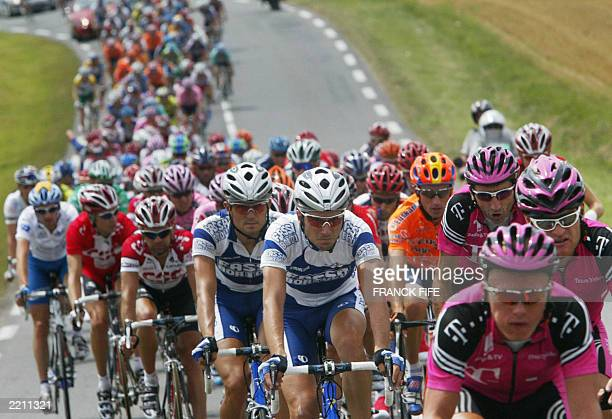 the pack rides during the 18th stage of the 90th Tour de France cycling race between Bordeaux and SaintMaixentl'Ecole 25 July 2003 AFP PHOTO FRANCK...