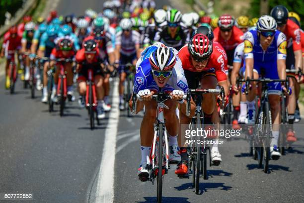 The pack rides during the 2075 km fourth stage of the 104th edition of the Tour de France cycling race on July 4 2017 between MondorflesBains and...