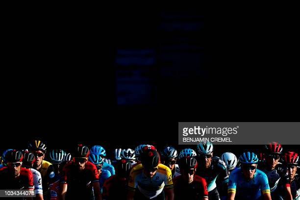 "The pack rides during the 21st stage of the 73rd edition of ""La Vuelta"" Tour of Spain cycling race 9 km race from Alcorcon to Madrid on September 16,..."