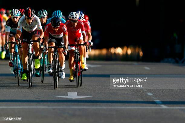 TOPSHOT The pack rides during the 21th stage of the 73rd edition of La Vuelta Tour of Spain cycling race9 km race from Alcorcon to Madrid on...