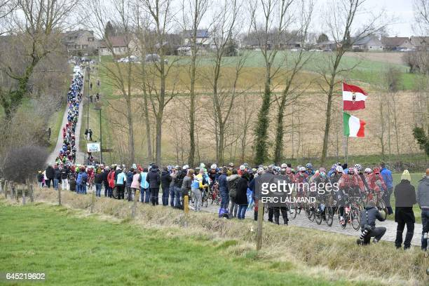 The pack rides during the 72nd edition of the Omloop Het Nieuwsblad cycling race on February 25 2017 near Gent Belgium The race 1983km from Gent to...