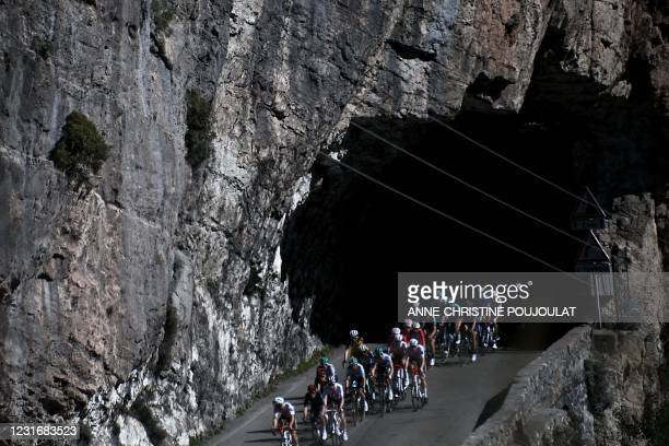 The pack rides during the 7th stage of the 79th Paris - Nice cycling race 5 km between Le Broc and Valdeblore La Colmiane, on March 13, 2021.