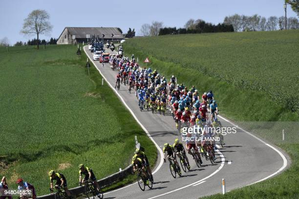 TOPSHOT The pack rides during the 82nd edition of the men's race of 'La Fleche Wallonne' a one day cycling race 5km from Seraing to Huy on April 18...