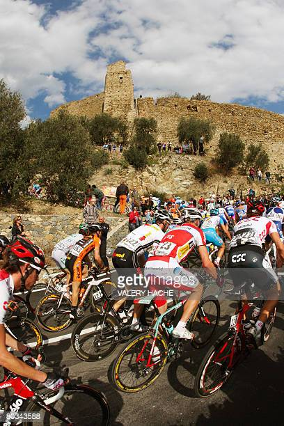 The pack rides during the 99th edition of Milan San Remo cycling race on March 22 2008 Swiss' Fabian Cancellara won the race ahead of Italian Filippo...