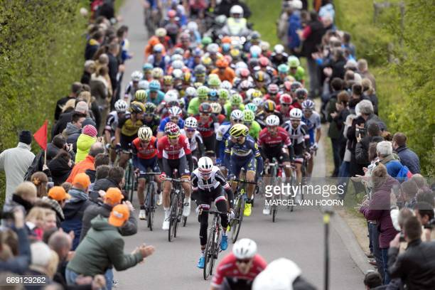 The pack rides during the Amstel Gold Race classic on April 16 2017 in Berg and Terblijt / AFP PHOTO / ANP / Marcel van Hoorn / Netherlands OUT