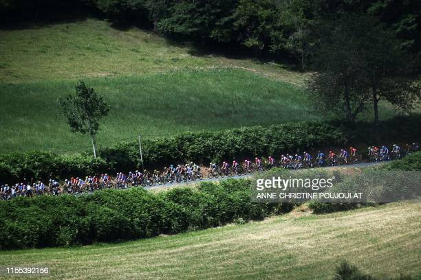 The pack rides during the eighth stage of the 106th edition of the Tour de France cycling race between Macon and Saint-Etienne, on July 13, 2019.
