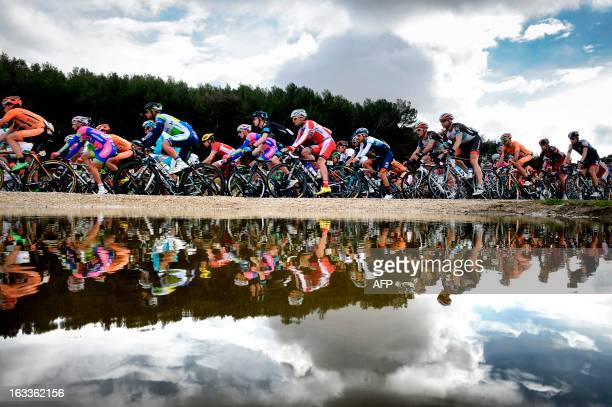 The pack rides during the fifth stage of the 71st Paris-Nice cycling race between Chateauneuf du Pape and La Montagne de Lure, near...
