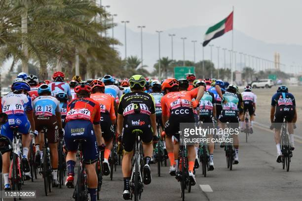 The pack rides during the fifth stage of the UAE tour from Sharjah to Khor Fakkan on February 28 2019