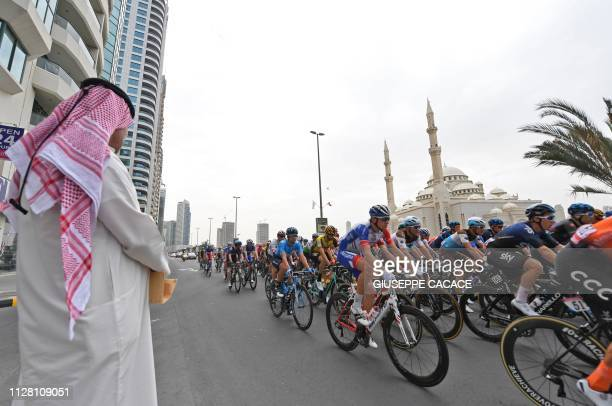 TOPSHOT The pack rides during the fifth stage of the UAE tour from Sharjah to Khor Fakkan on February 28 2019