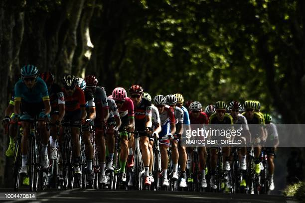 TOPSHOT The pack rides during the first kilometers of 16th stage of the 105th edition of the Tour de France cycling race between Carcassonne and...