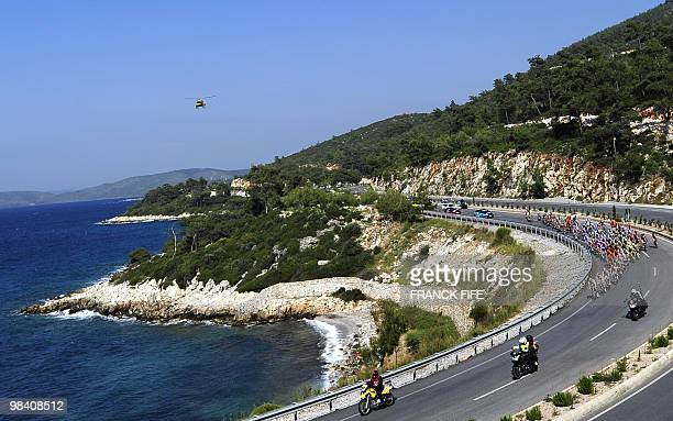 The pack rides during the first stage of the 2010 Tour of Turkey cycling race run between Kusadasi and Turgutreis on April 12 2010 Germany's Andre...