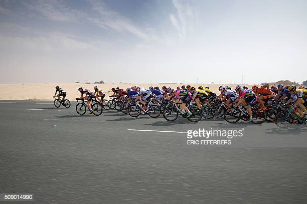 TOPSHOT The pack rides during the first stage of the 2016 Tour of Qatar between Dukhan and Al Khor Corniche on February 8 2016 Britain's Mark...