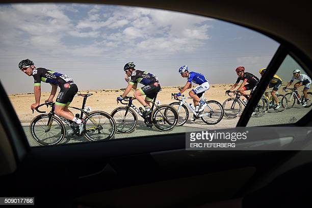 The pack rides during the first stage of the 2016 Tour of Qatar, between Dukhan and Al Khor Corniche on February 8, 2016. Britain's Mark Cavendish,...
